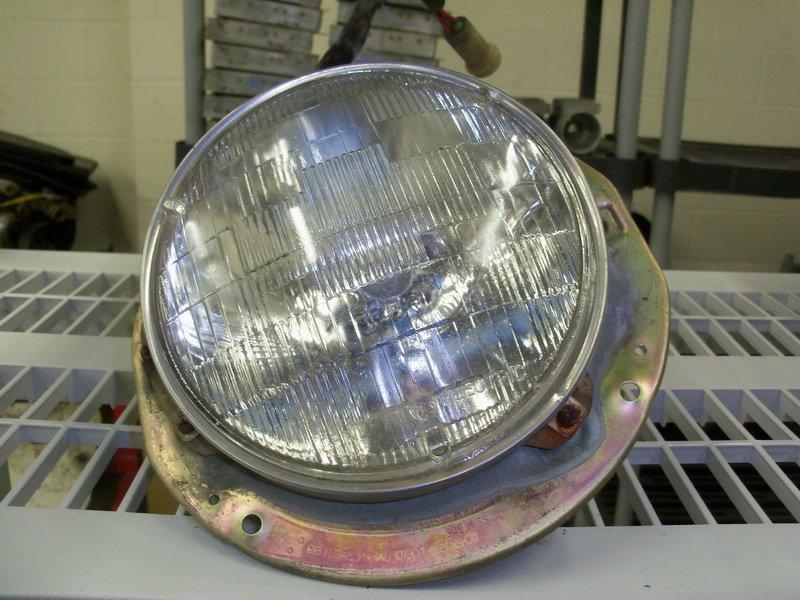 Drivers side headlight assemblyand bulb
