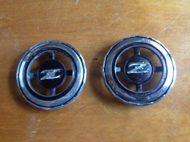 Rear upper quarter panel emblems